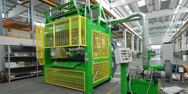 Arrotolatore per lana di vetro